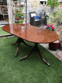 Twin Pedestal tilting dining table.