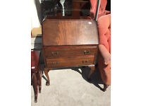 Vintage Bureau , with ball and claw feet , leather insert .