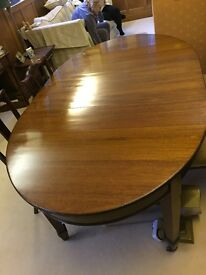 Antique dining table and 4 chairs.