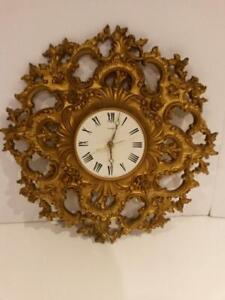 50s Vintage Syroco Clock Bassett 19 Inch Hermosa in Gold Leaf starburst frame, ornate gold rococo wall clock case