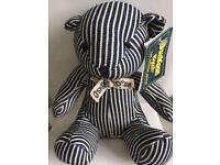 Oshkosh bgosh genuine new teddy bear with labels attached .