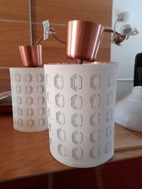 Two rose gold light celing fitment , with cream shades