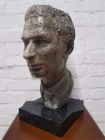 A plaster patinated bust of a gentleman,possibly George VI, on granite base (DELIVERY AVAILABLE)
