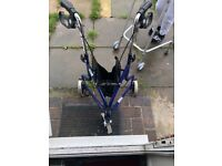 Brand new 3 wheeled walker with black leather basket ..........£45 ONO
