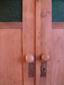 REDUCED Antique pine cupboard with ornate inset green glass in doors.