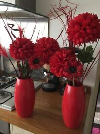 Red vases and flowers