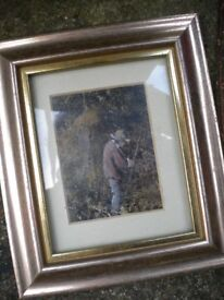 A VERY OLD REFRAMED OIL ON CANVAS 6X4 INCHES DIPICTING A FISHERMAN