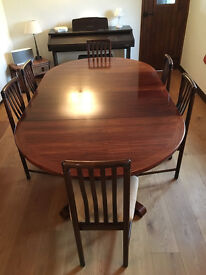 Rosewood Extending Dining Table and six Chairs