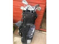 Bag full of golf clubs