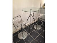 Glass topped bar table with chrome legs - diameter 600mm, height 1040mm