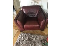 DFS brown leather armchair. Like new. Comes with leather care wipes