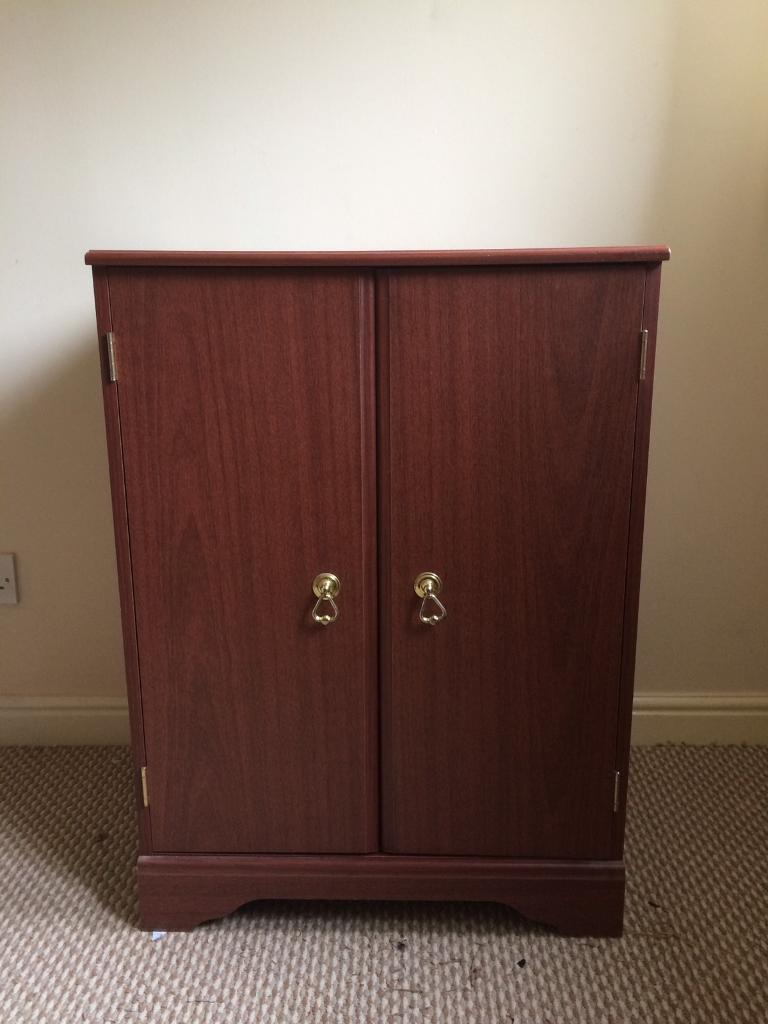 Storage cupboard lift up lid