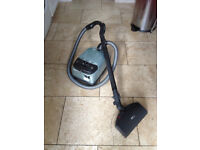 Miele Revolution Vacuum cleaner with electrically powered turbobrush head.