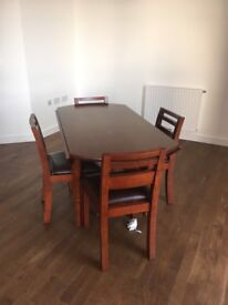 Extendable wood dining table and leather chairs