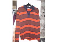 Lacoste orange striped polo shirt size large (slim fit). Has been worn but is in good condition.