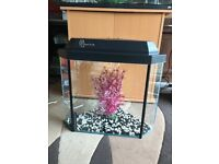 Triangle fish tank very nice and v g c with light lid nice gravel and ornament look pic
