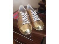 Gold adidas trainers size 6