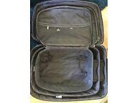 3x black suitcases
