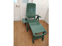 Never used Plastic Green Sun Lounger/ Long Reclining Chair with Footrest and Shelf/ Tray.