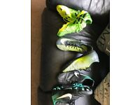 Three pairs football boots