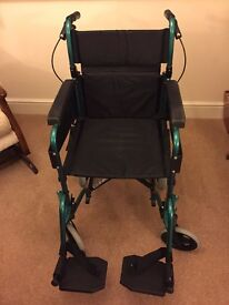 Wheelchair - Folding - hardly used - with brand new cushion