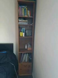 Tall bookcase with draw