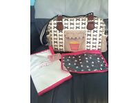Yummy mummy pink lining nappy changing bag with accessories.