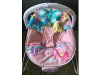 Mothercare Fairground baby bouncy chair with toy bar.