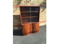 """Large display cabinet with two cupboards. Good condition - solid wood. 54"""" high, 36"""" wide."""