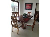 A Grand Extending Dining Table & 8 chairs