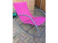 Pink rocking garden chair