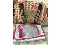 Pink lining red butterfly changing bag