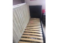 A brown leather sleigh single bed frame, great condition; mattress and mattress topper included