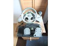 XBox 360 plus Madcatz Steering wheel plus games