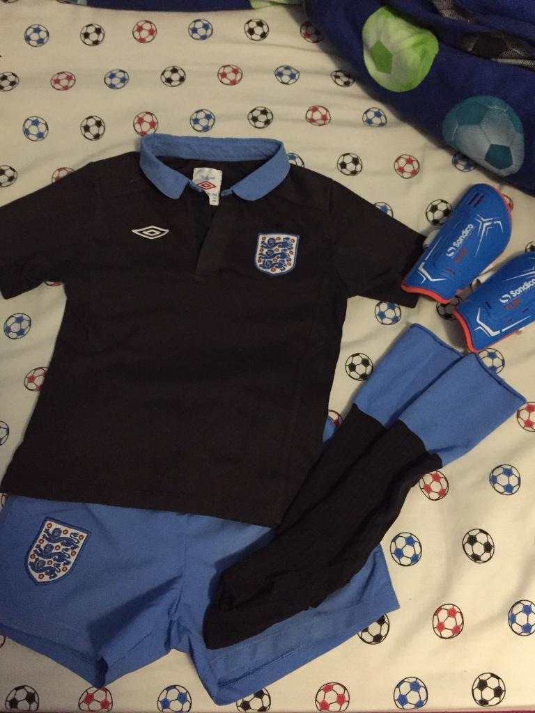 Football kit and top and shorts set