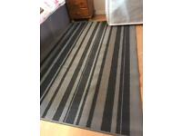 Grey rug, carpet.