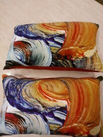 Set of 2 patterned cushions. Orange, Blue, Mustard swirl. Excellent condition