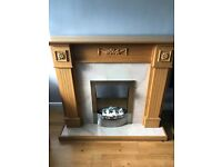 Oak surround fireplace with electric fire