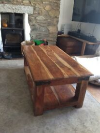 Solid Acacia coffee table in good condition, very sturdy with storage space on lower shelf.
