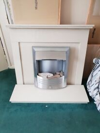 Cream solid marble fireplace with electric fire