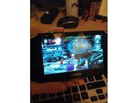 Playstation Vita + 2 games + case