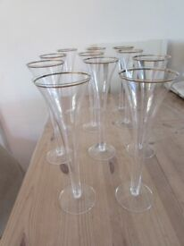 Set of 11 glass champagne flutes gold rim trumpet shape