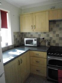 Complete kitchen with cupboards and drawers, including integrated cooker hood and sink