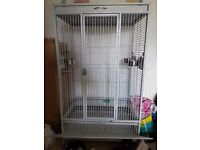 Large bird cage only used for a fortnight as parrot didn't like it.