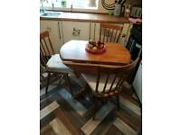 Solid pine table with 4 chairs and cushions in excellent condition
