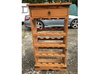 Pine rack with drawer