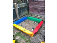 A big plastic sandpit good quality and in great condition