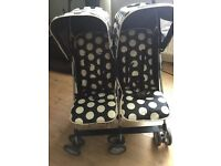 Black and white spotted twin pushchair