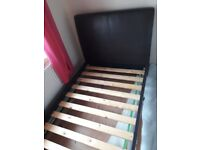 Brown faux leather single bed in good condition this has been flat packed