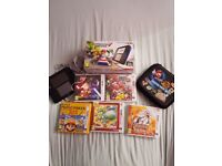 Nintendo 2ds pre installed Mario kart 7 plus 5 games and a case . Great condition and all boxed